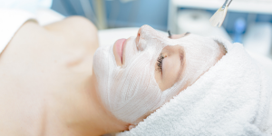Woman with a facial masks relaxing