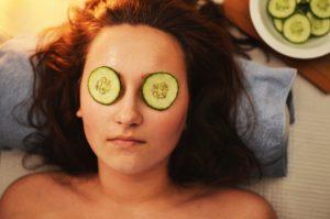 Woman at a spa receiving a facial