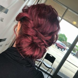 TSPA student with red hair shows off bridal hairstyling